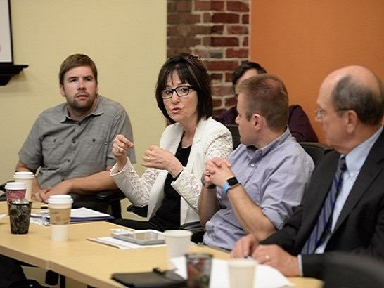 Photo of business leaders discussing New Hampshire's workforce.