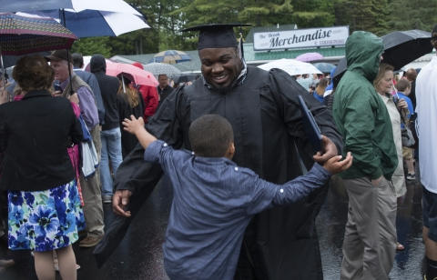 Granite State College grad with little boy